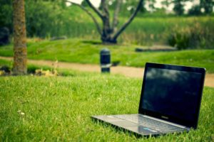 Hiring Remote Workers (laptop in a grassy park)